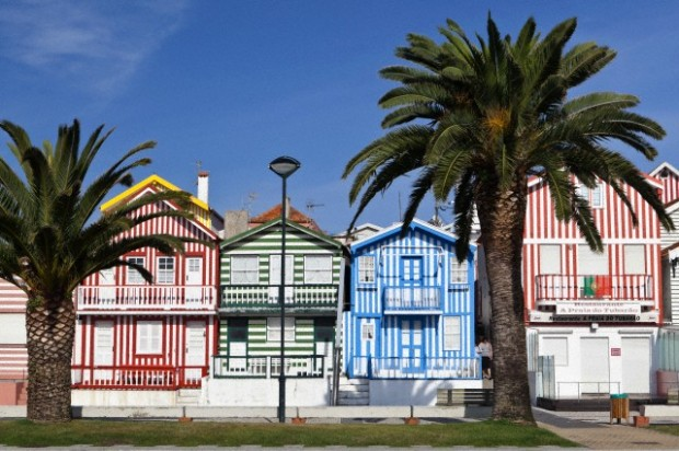 Candy striped painted beach houses, former fishermans houses in Costa Nova, Beira Litoral, Portugal