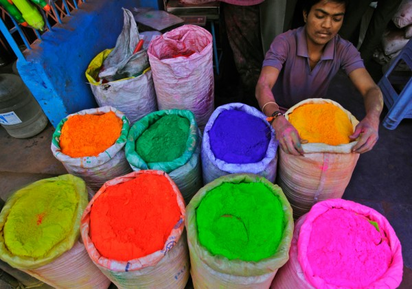 An-Indian-vendor-arranges-the-arsenal-for-celebrants-of-Holi-colored-powder-at-his-shop-in-Hyderabad-India-on-March-18-600x421