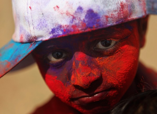 Colored-powder-covers-the-face-of-a-boy-in-Mumbai-on-March-18.-The-main-day-of-the-holiday-of-Holi-was-Sunday-March-20-but-participants-flung-colors-at-one-anoth