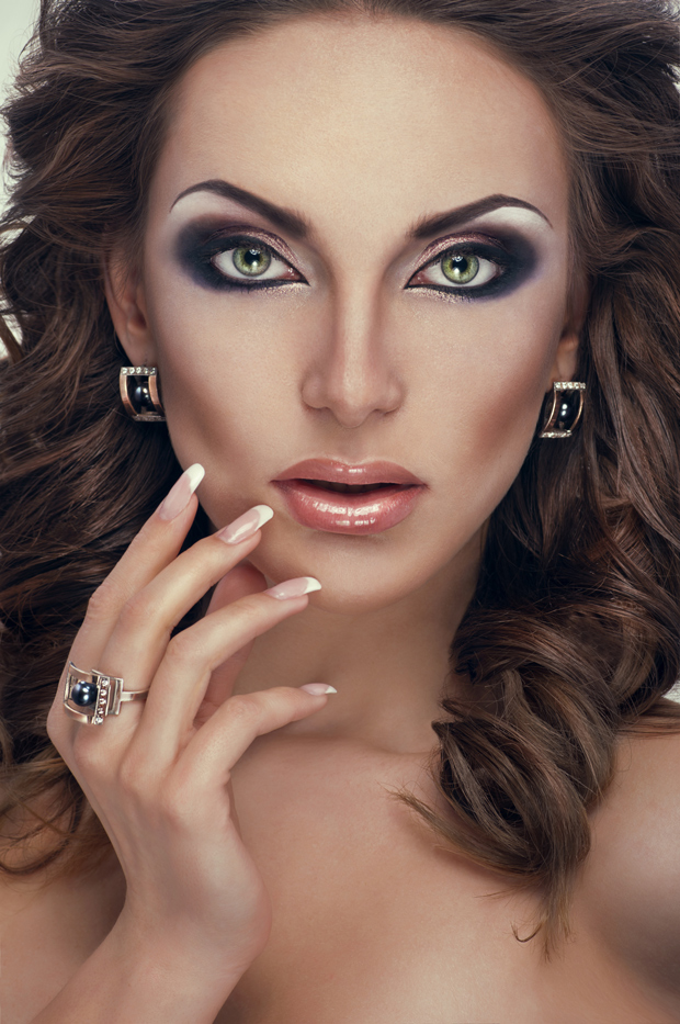 Beautiful Woman with Luxurious Make Up and Posh Jewelry