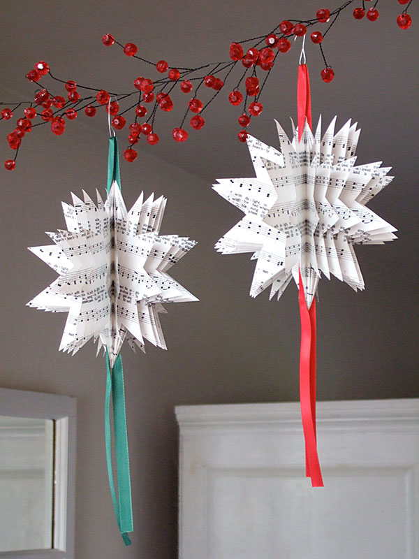 take any paper of your choice and make pretty paper ornaments for hanging from the christmas tree - Christmas Decorations On The Cheap