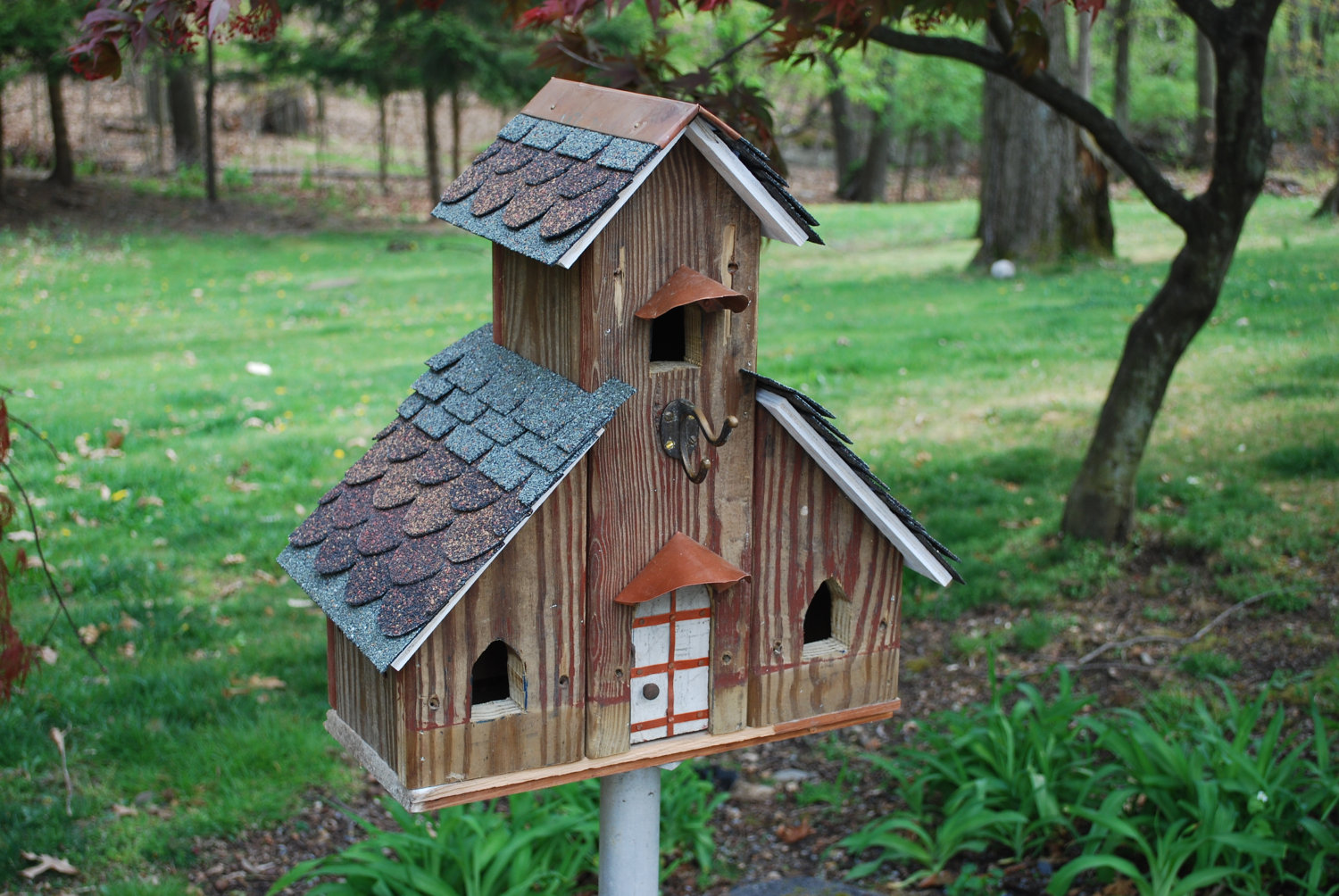 15 decorative and handmade wooden bird houses style - Three wooden house plans ...