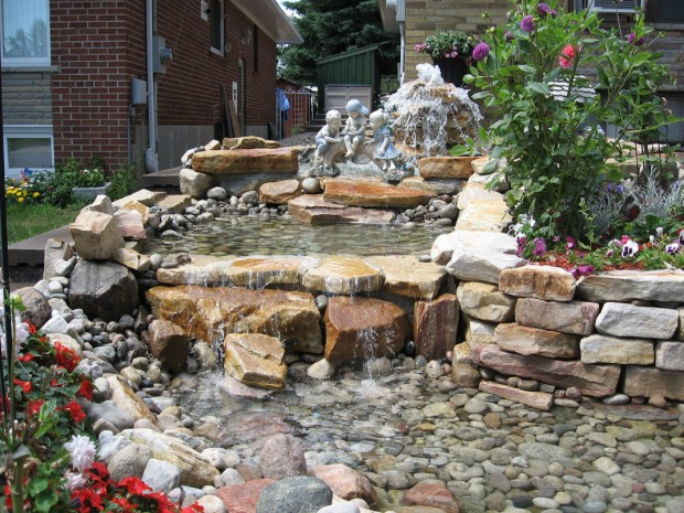 Natural-Stone-Waterfall-Pond-Design-with-Kid-Statues-for-Home-Garden-Landscaping-Ideas