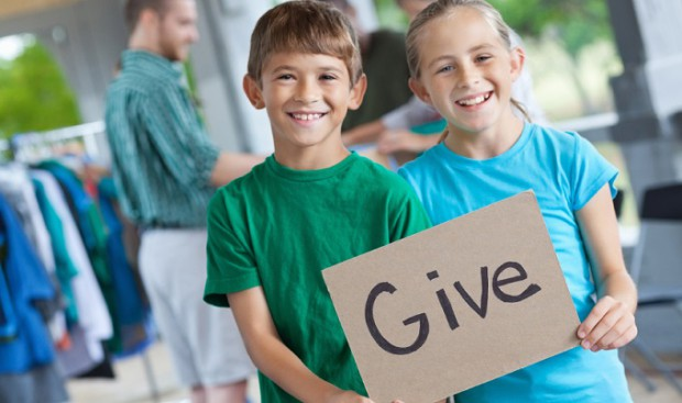 KIDS-HOLDING-GIVE-SIGN