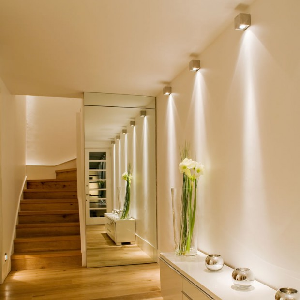 astonishing-home-hallway-interior-design-with-illuminating-bright-wall-lamps-feats-spotlight-shade-above-upholstered-white-wooden-buffet-wall-unit