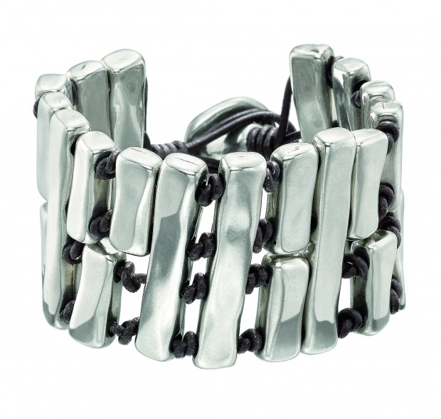 Wide bracelet consisting of various silver-plated metal rectangular blocks separated from each other by brown leather knots.