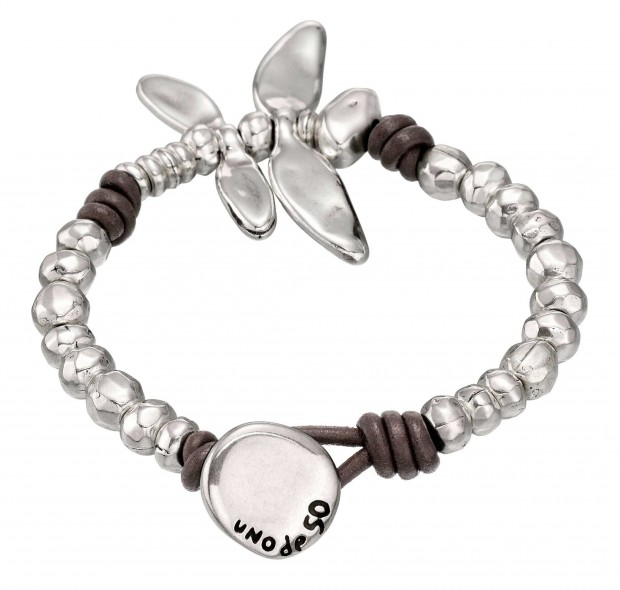 Unique bracelet with rounded beads and a silver-plated dragonfly charm linked together with leather knots. Hand-crafted in Spain.