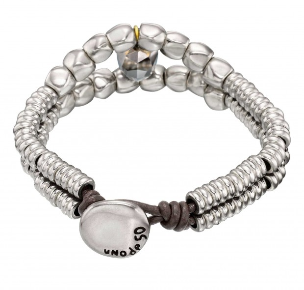 Double bracelet with round trinkets and a faceted grey toned SWAROVSKI® crystal skull. Hand-crafted in Spain.