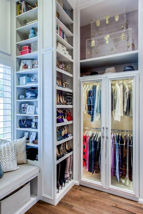closet-built-in-shoe-shelves-clear-acrylic-trunks-brass-leather-hardware