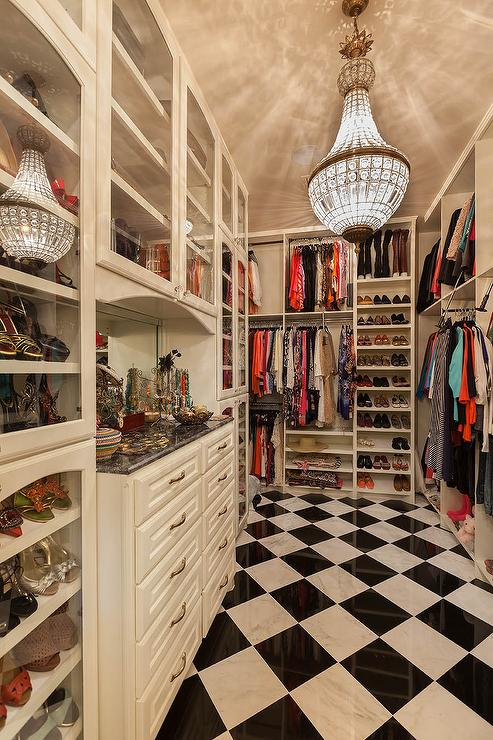 french-closet-chandelier-walk-in-closet-black-and-white-harlequin-tile-floor