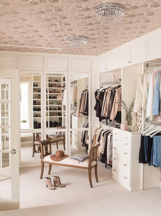 pink-wallpapered-closet-ceiling-mirrored-wardrobes-built-in-lingerie-dresser