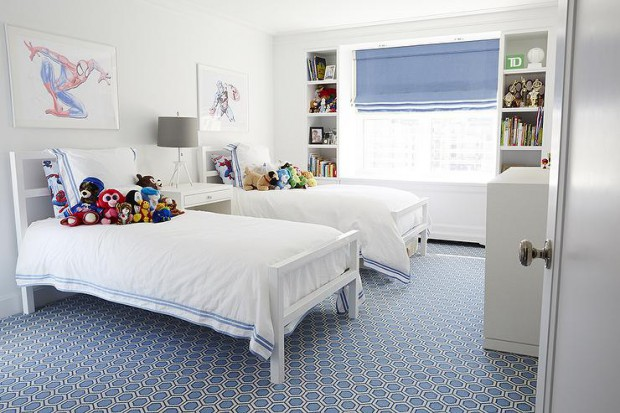 white-and-blue-shared-boys-bedroom-blue-hexagon-rug-window-between-bookcases