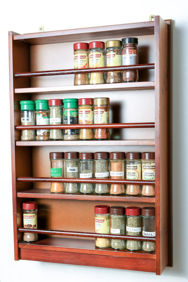 This spice rack can store spice and herb bottles across four shelves and can be wall mounted or placed freestanding in the kitchen or pantry.