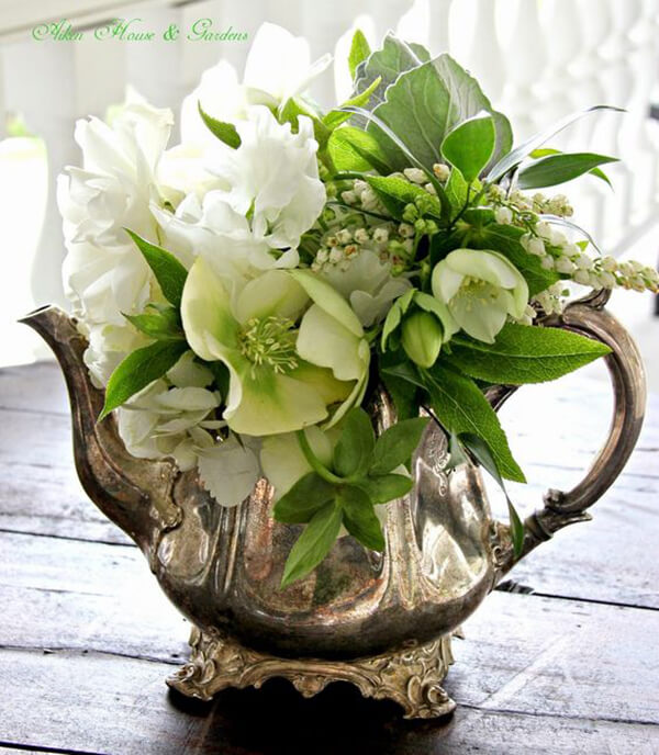 Silver Teapot with Green and White Arrangement