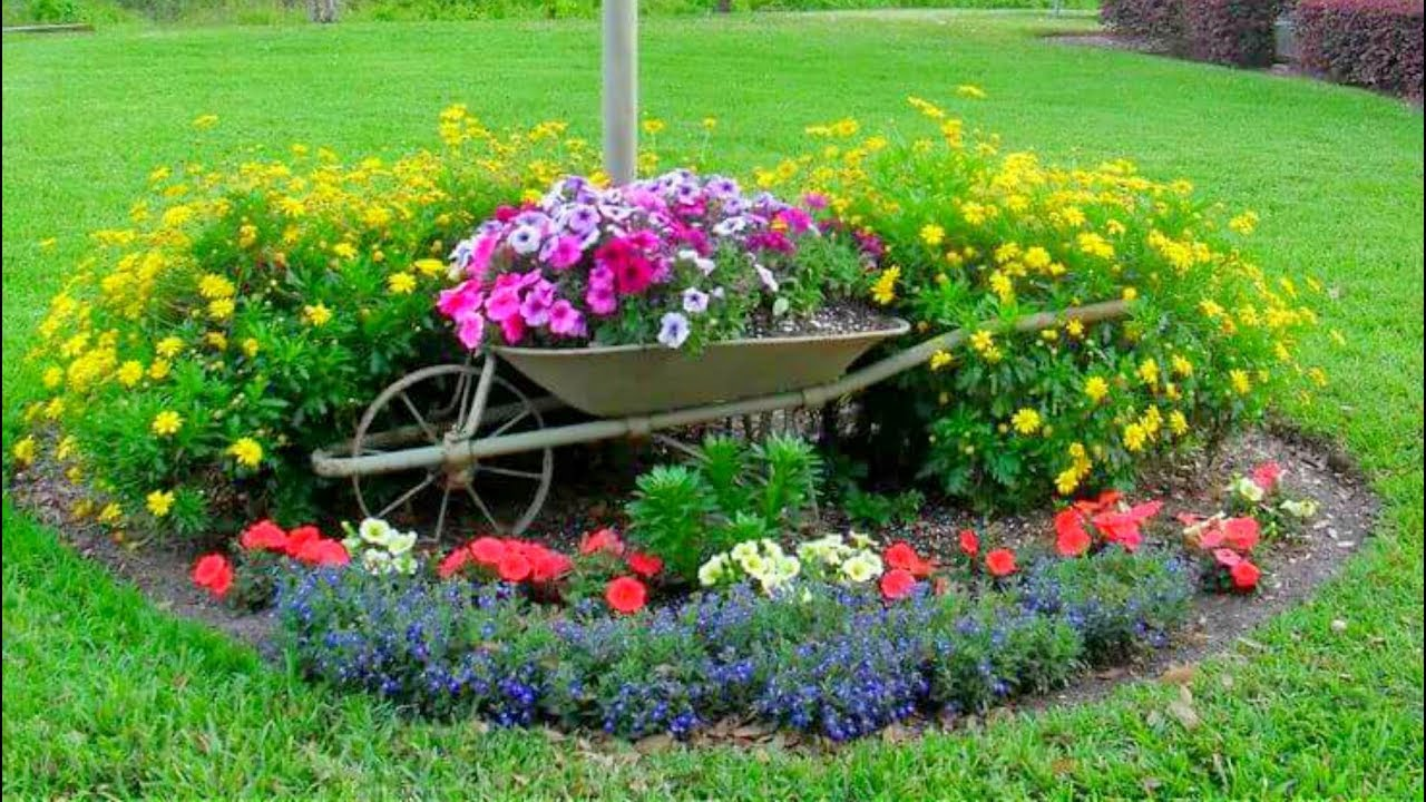 15 DIY Wheelbarrow Repurposing Ideas