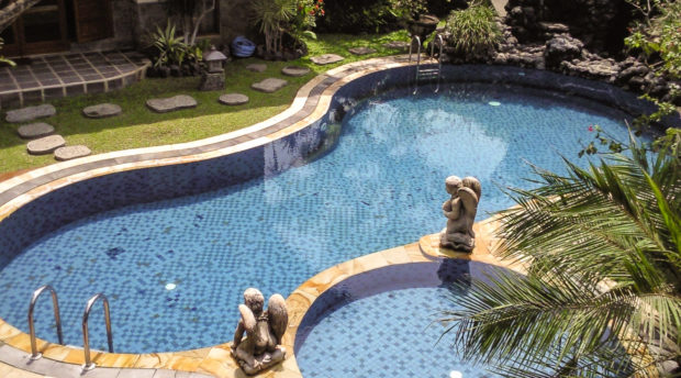 Grassed pool surrounds are even cheaper and very easy to maintain