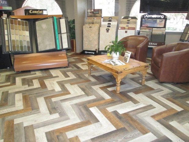 Luxury vinyl cut into strips and laid in a herringbone pattern