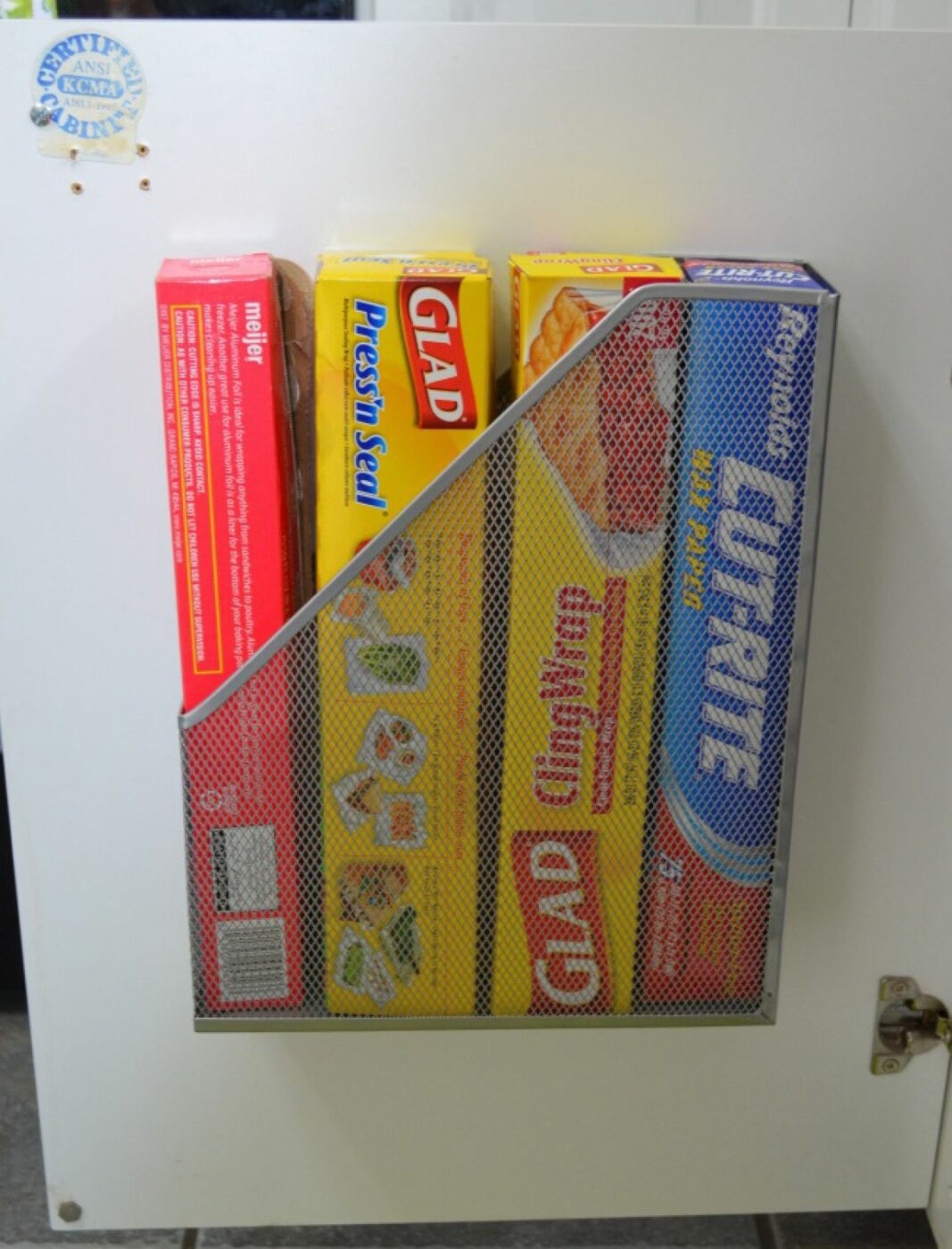 Attach a Magazine Rack Inside Cabinet Doors For Added Storage