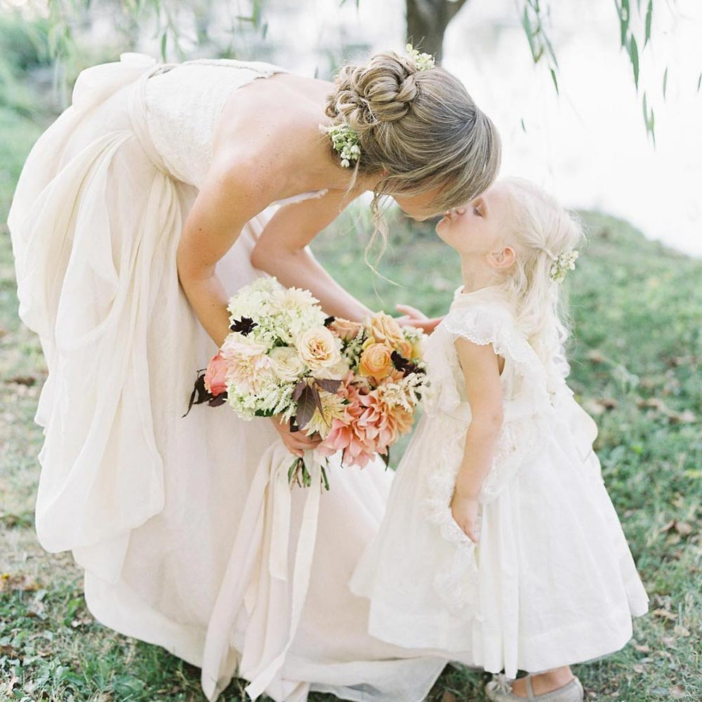 sweet flower girl kiss
