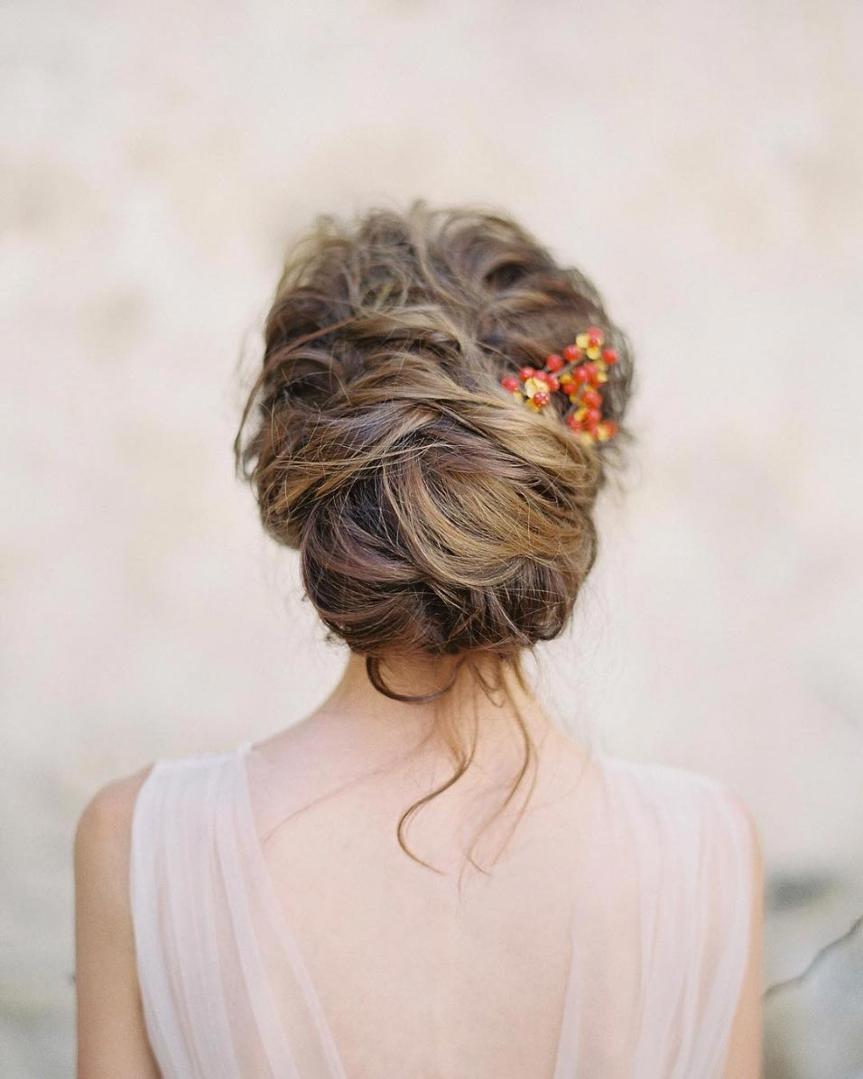 messy wedding updo thick wavy hair