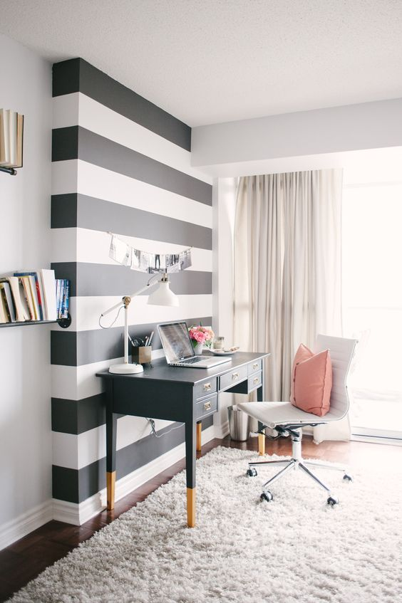 Awesome black and white stripe accent wall in a Hollywood regency style office--image via Style Me Pretty