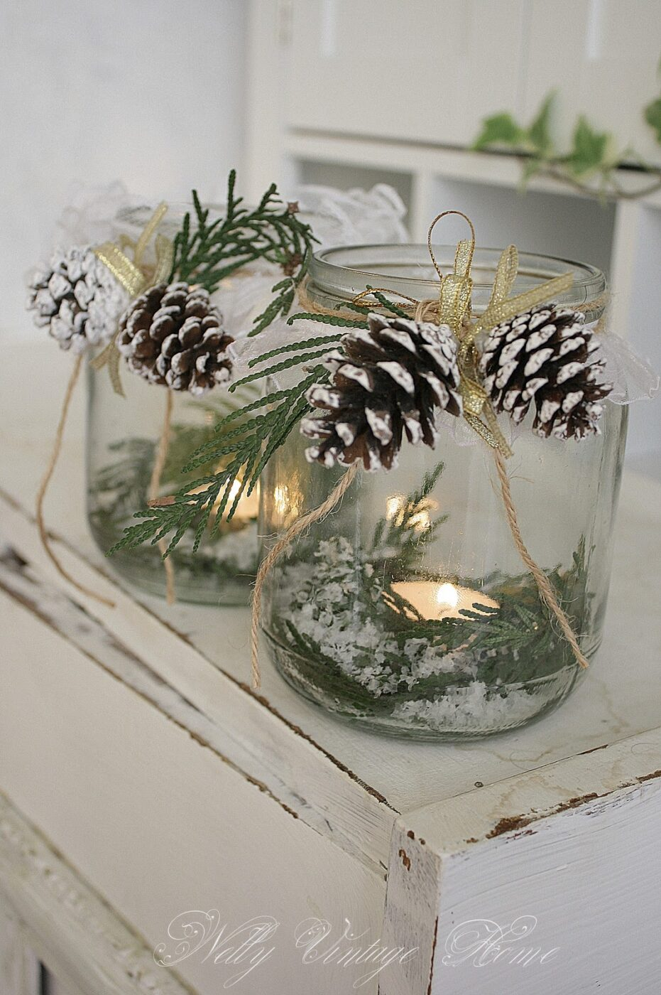 Tea light in a jar with greens | 25+ Winter decor crafts