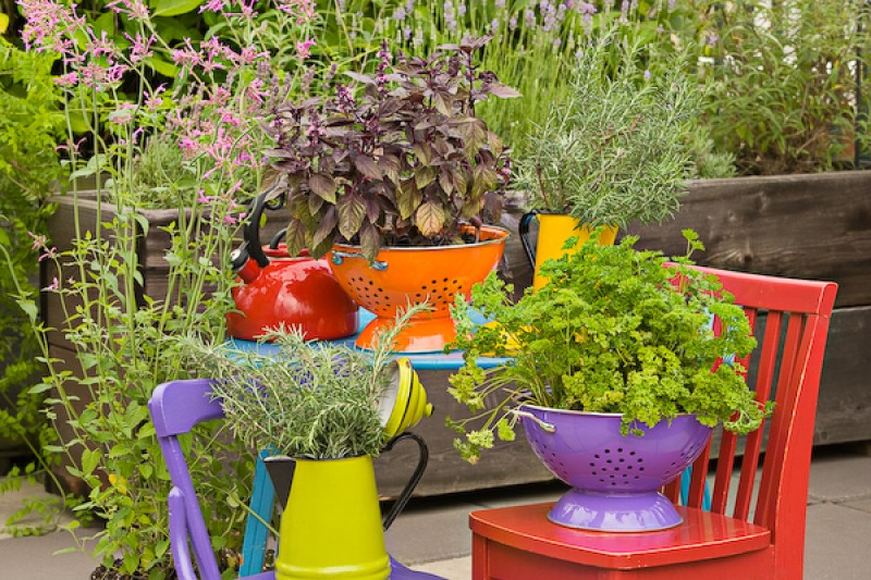 Use colanders for garden planters. They are colorful and offer good drainage.
