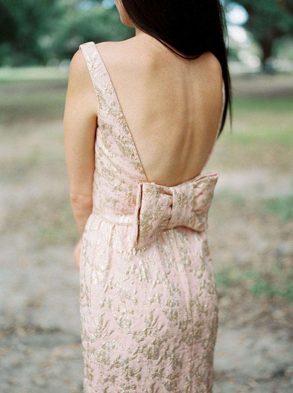 backless wedding dress with pink and gold