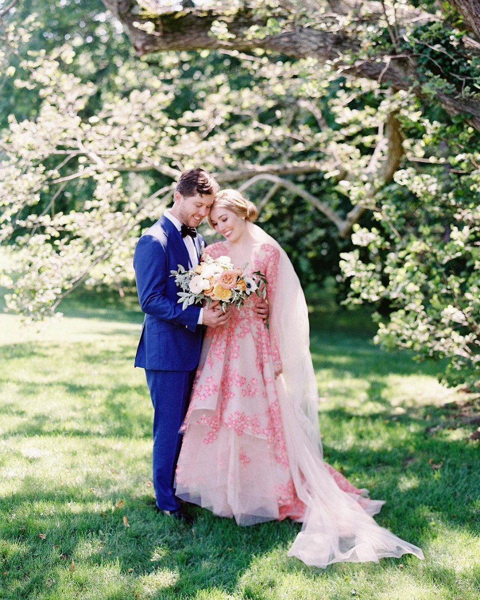 pink embroidered wedding dress with cobalt blue groom suit