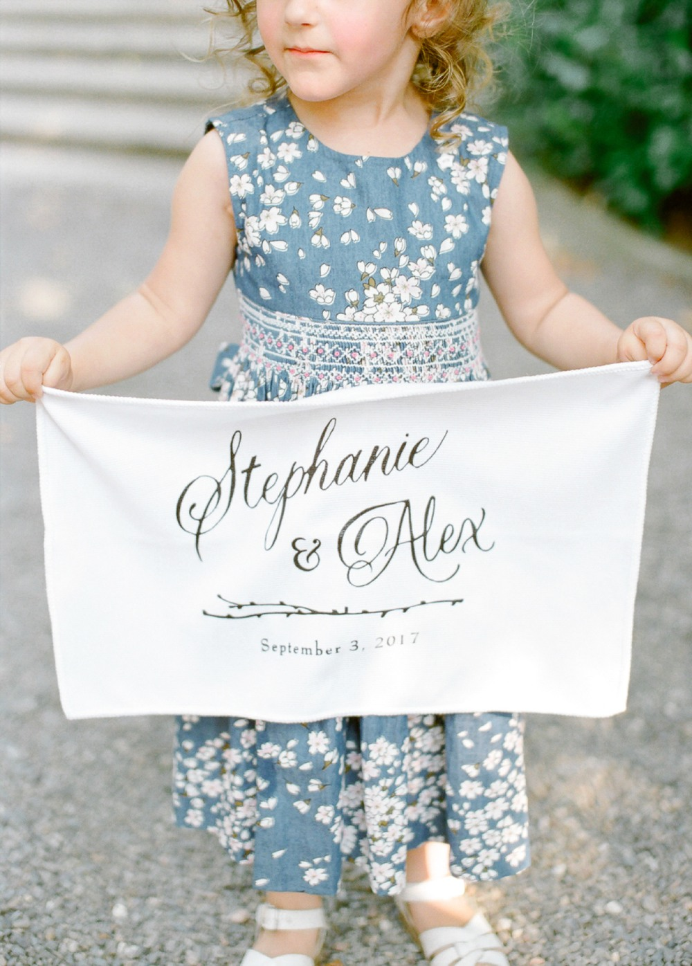 blue printed flower girl dress with linen banner