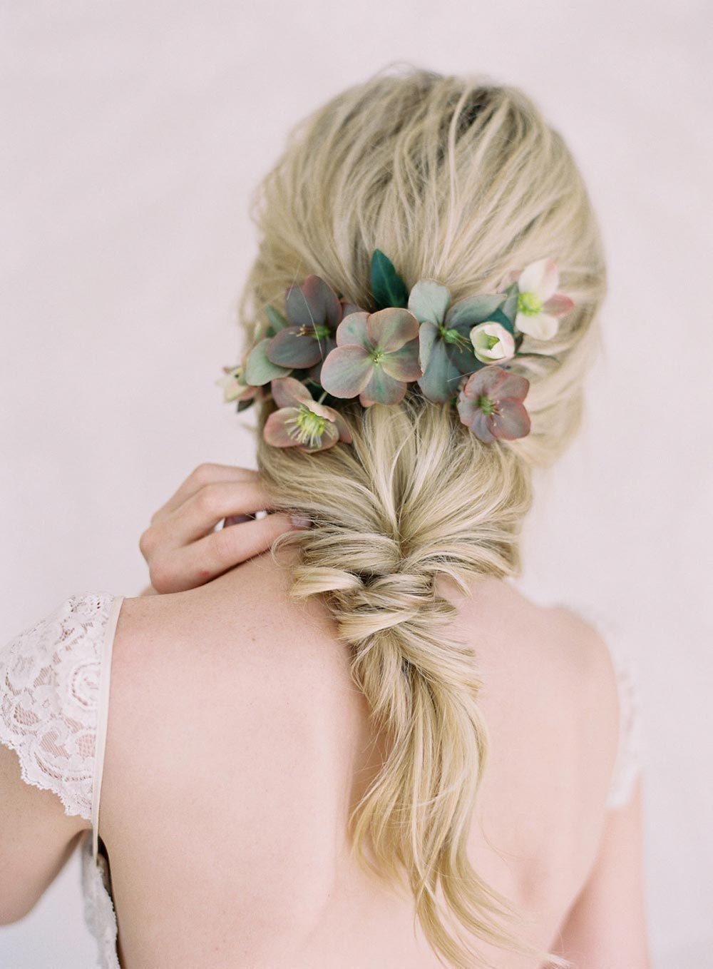 loose bridal ponytail with flowers