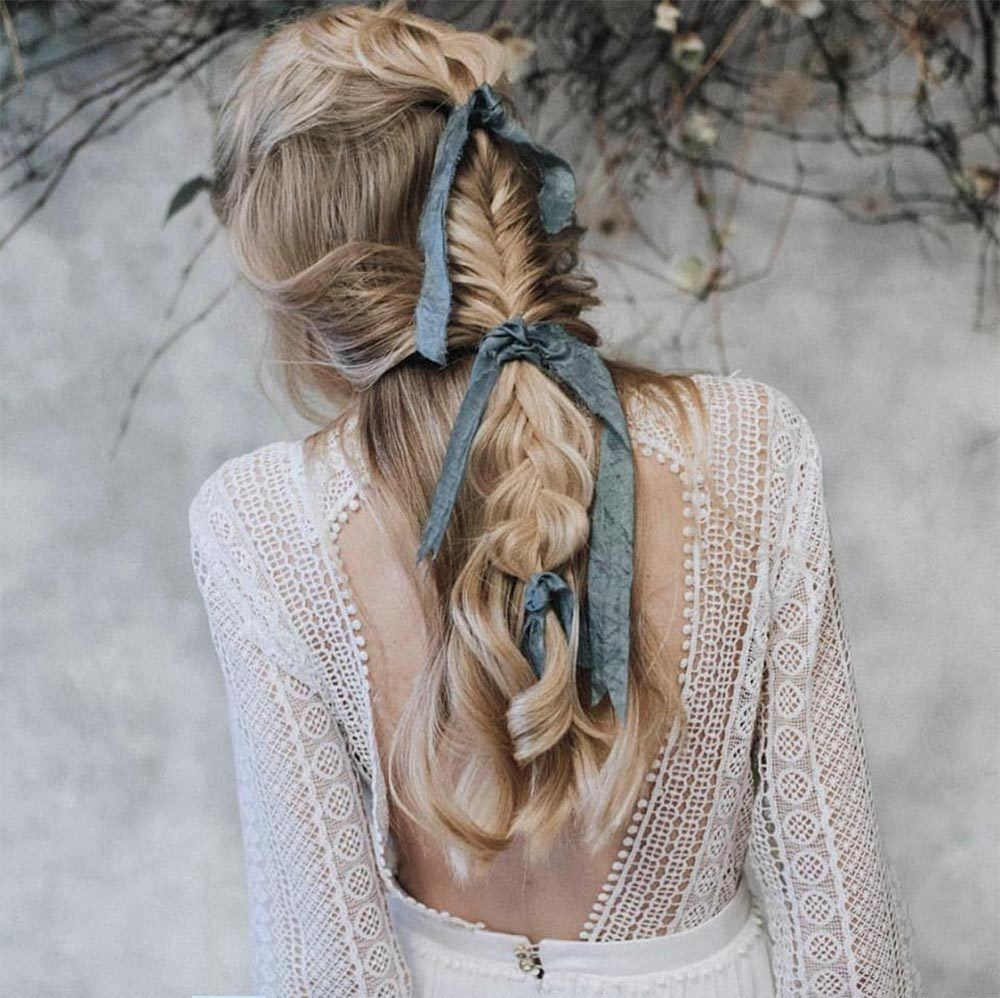 loose bridal braids with blue ribbons