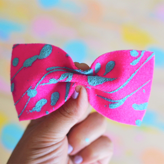 Splattered felt hair bow