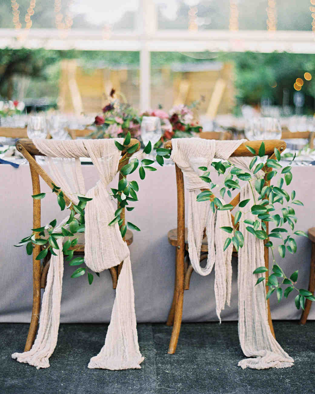 draped linen chair swag with greenery