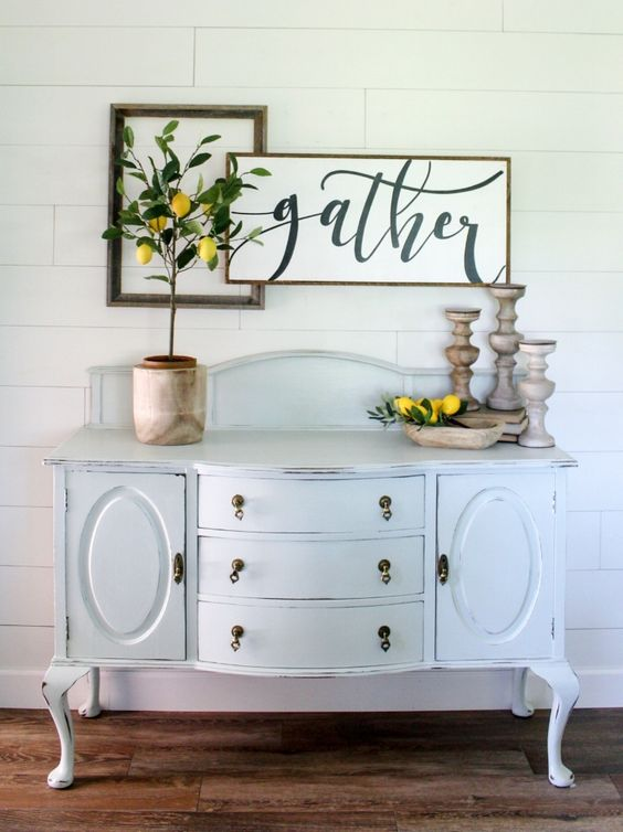 Pretty shiplap wall! Love the vintage hutch and lemon tree decor!