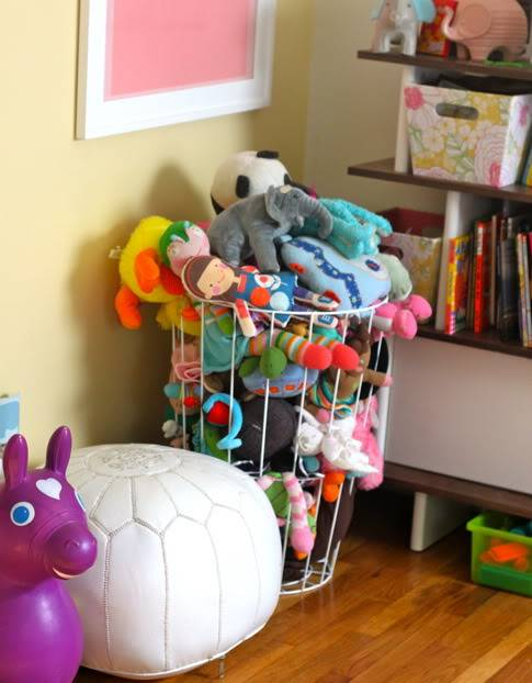 20+ Creative DIY Ways to Organize and Store Stuffed Animal Toys --> Wire Hamper As Stuffed Animal Storage
