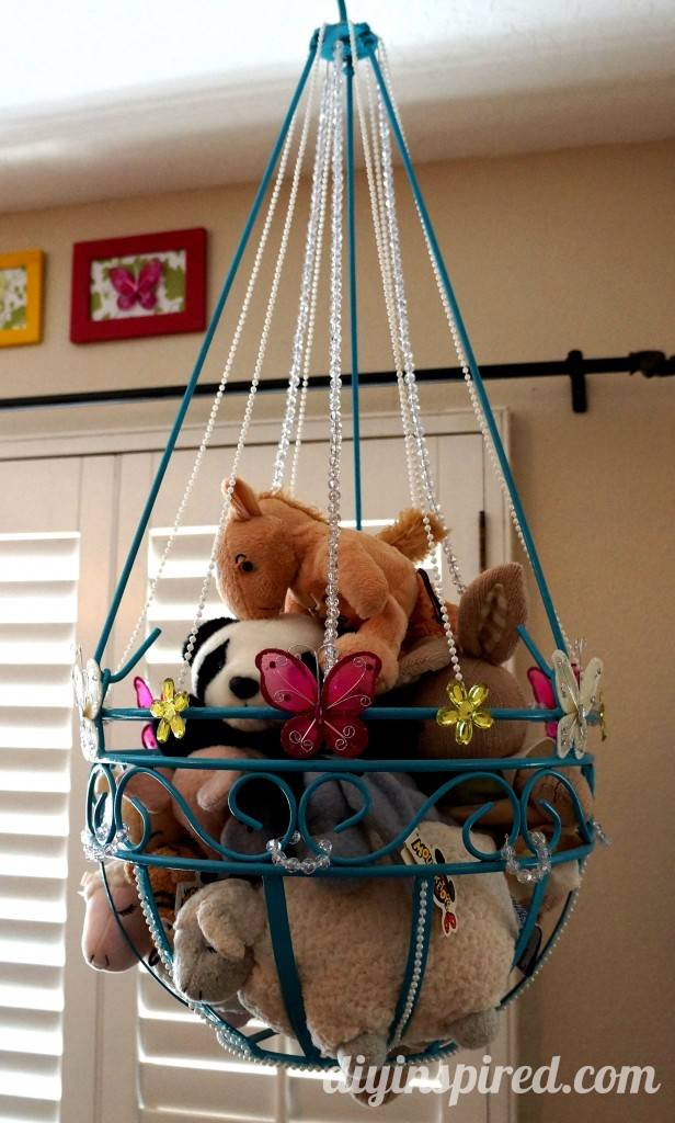 20+ Creative DIY Ways to Organize and Store Stuffed Animal Toys --> DIY Stuffed Animal Toy Storage From Old Plant Hanger