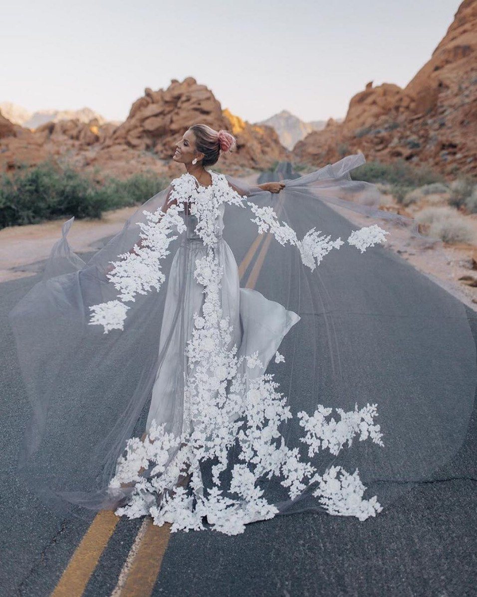 bridal cape statement with intricate embroidery and national park scenery