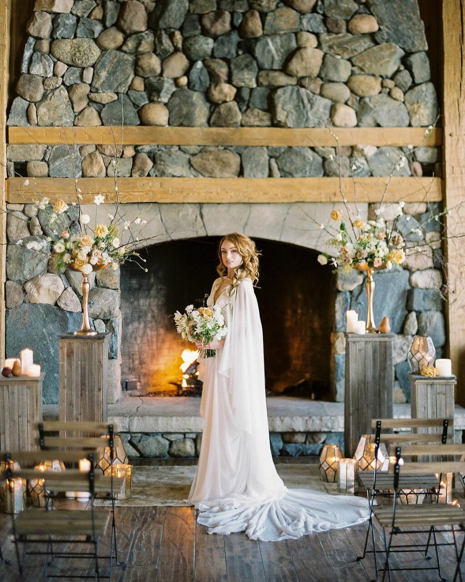 winter wedding bride and groom with sleek bridal cape