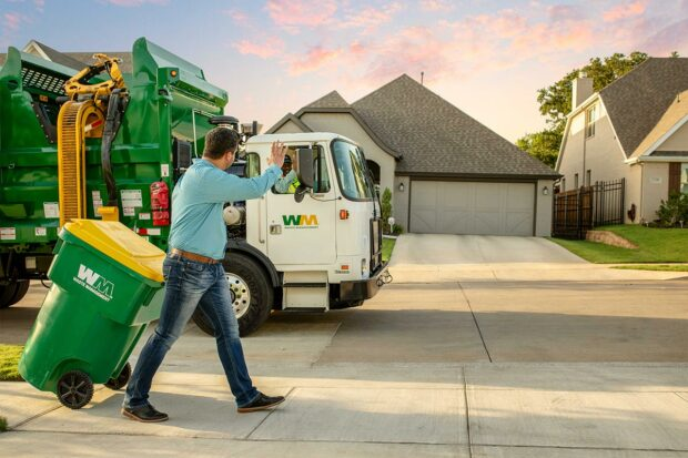 Residential Customer with Waste Management Recycling Bin and Waste & Recycling Pickup Truck