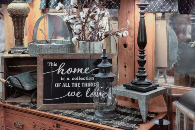 """Rustic wood and galvanized home decor display with a sign that says """"This home is a collection of all the things we love"""""""